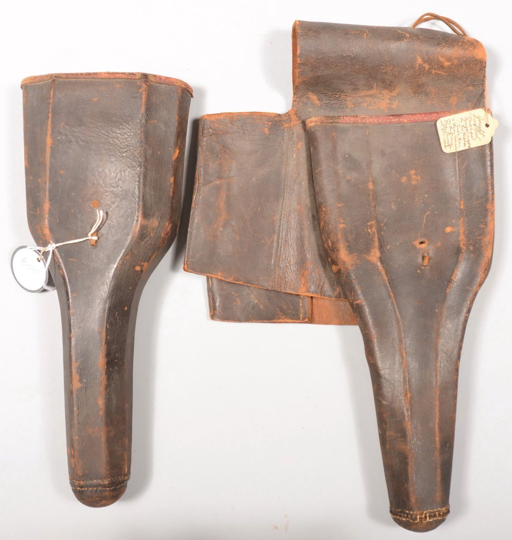 73: Pair of leather holsters for horse pistols. One is