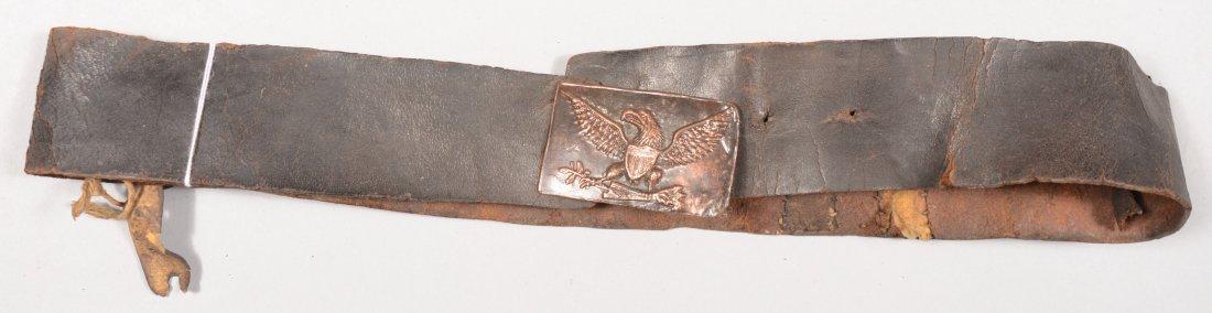 74: Leather waist belt dyed black having a Common Milit