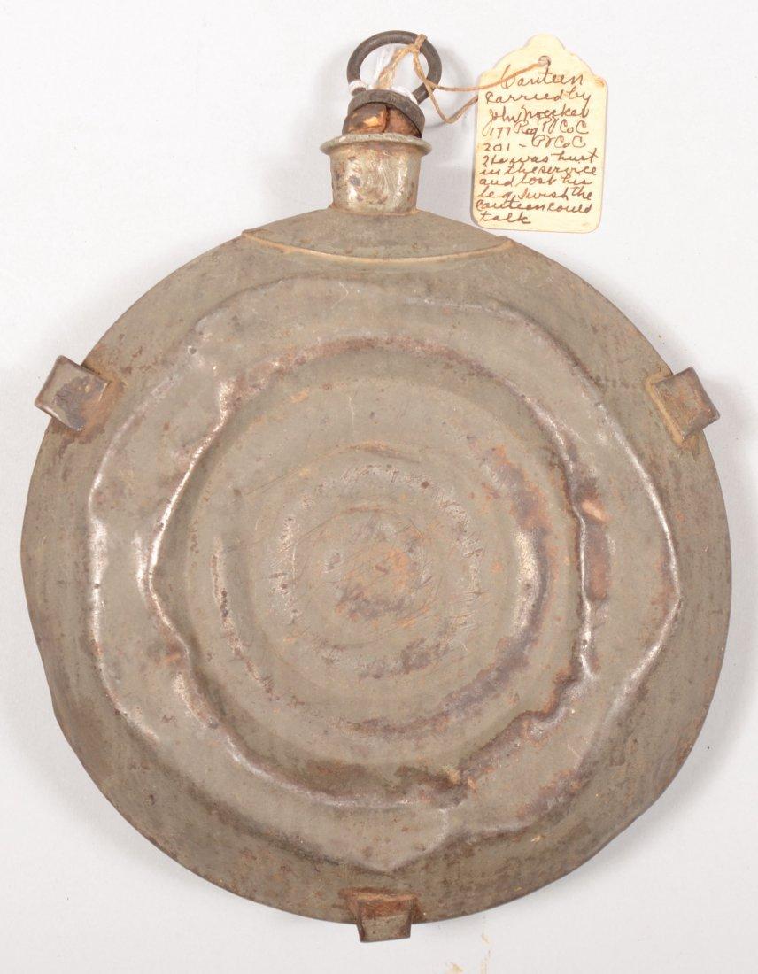 79: Civil War bullseye canteen having a tag identifying