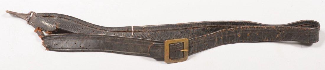 89: Mid-nineteenth century black folded leather sling w