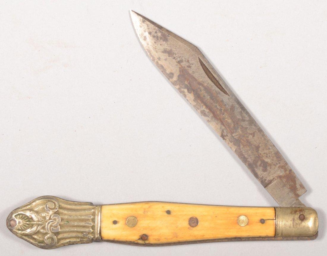 "96: Folding knife having ivory grips, unmarked 4-1/8"" b"