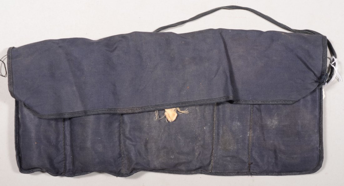 """200: Dark blue housewife labeled """"Tack twill water repe"""