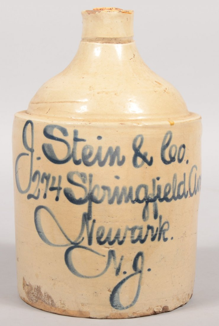 89: Salt Glazed Stoneware Advertising Jug. Straight sid