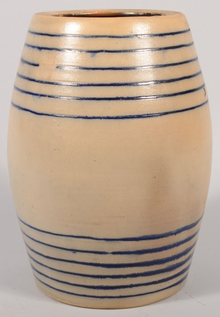 100: Large Ovoid Stoneware Barrel. Having six parallel
