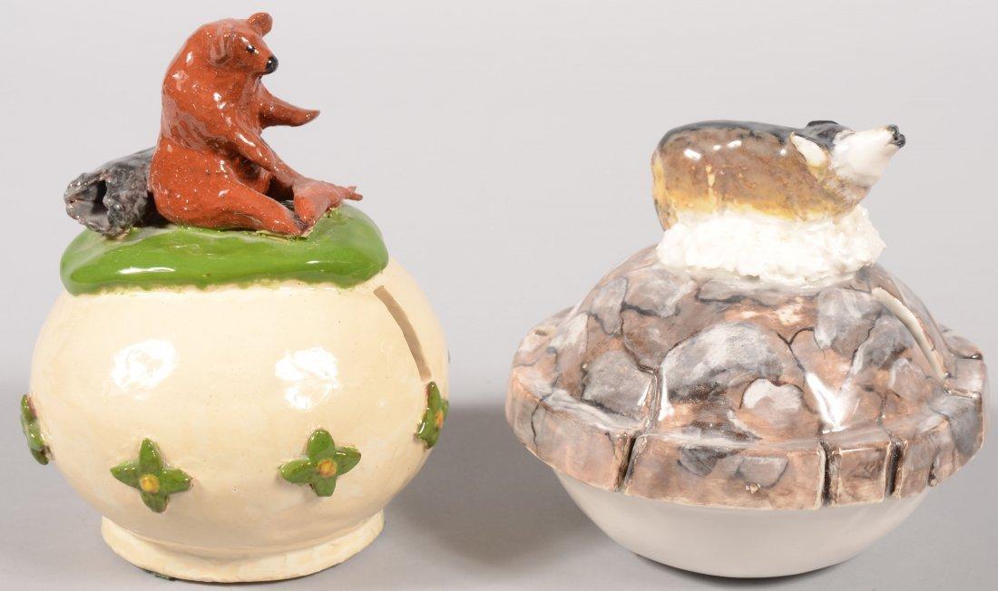 104: Two Contemporary Folk Art Stoneware Coin Banks. A