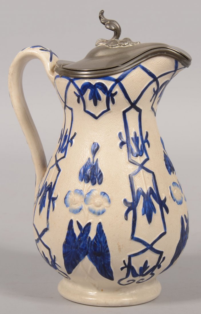 517: Covered Parian Pitcher. Matte finish with raised a