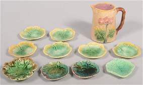 735 Two Groups of Etruscan Majolica Marked Butter Pats