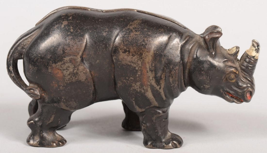 11: Cast Iron Rhinoceros Still Bank. Arcade. Painted bl