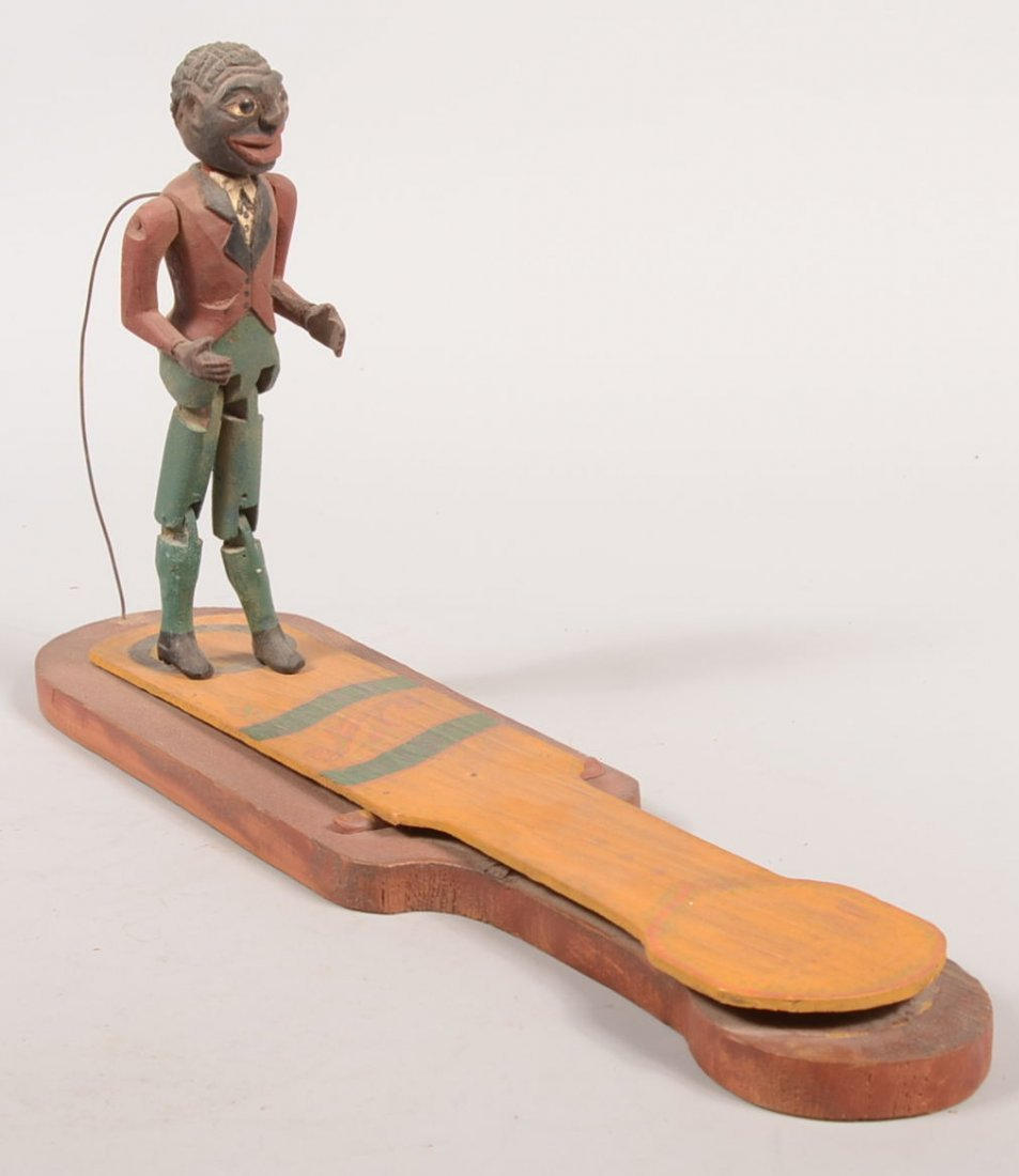 15: Painted Jigger Dancer on slap Board. Black human fi