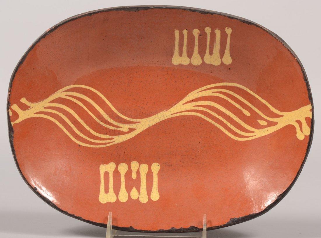 Oblong Redware Loaf Dish. Six line slip designs to inte