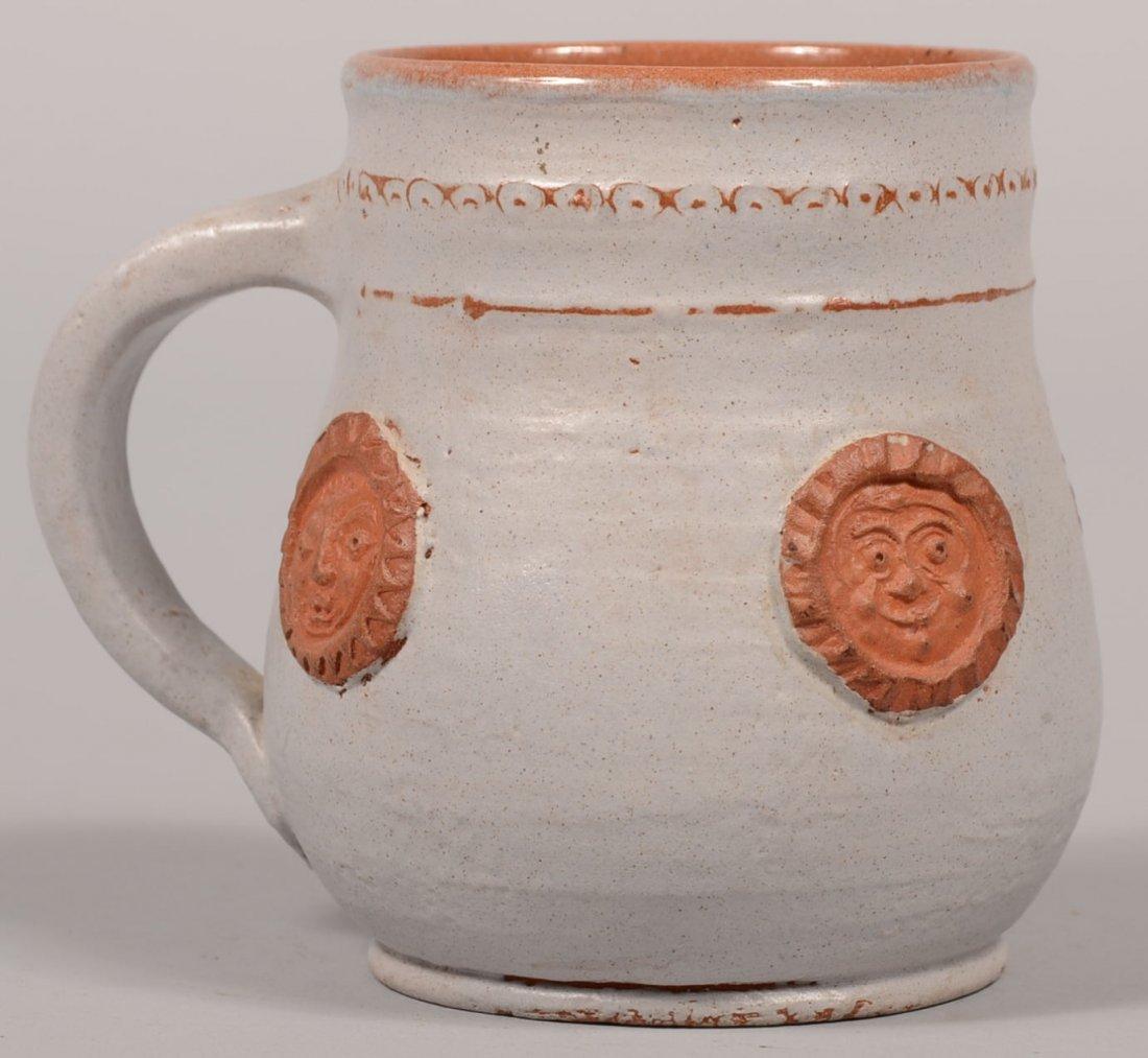 Left Handed Russel Henry Signed Redware Mug. Bulbous bo