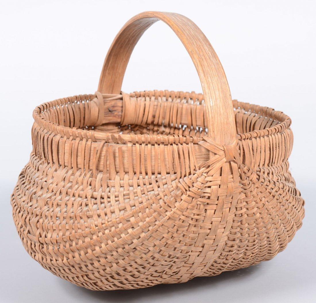 7. Woven Splint White Oak Gathering Basket. Round form