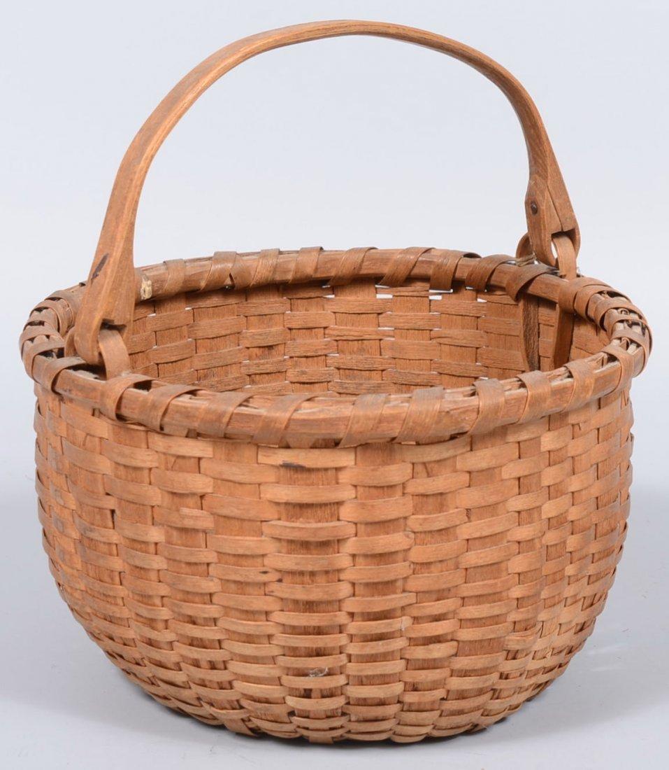 10. Round Split White Oak Swing Handle Basket. Wrapped