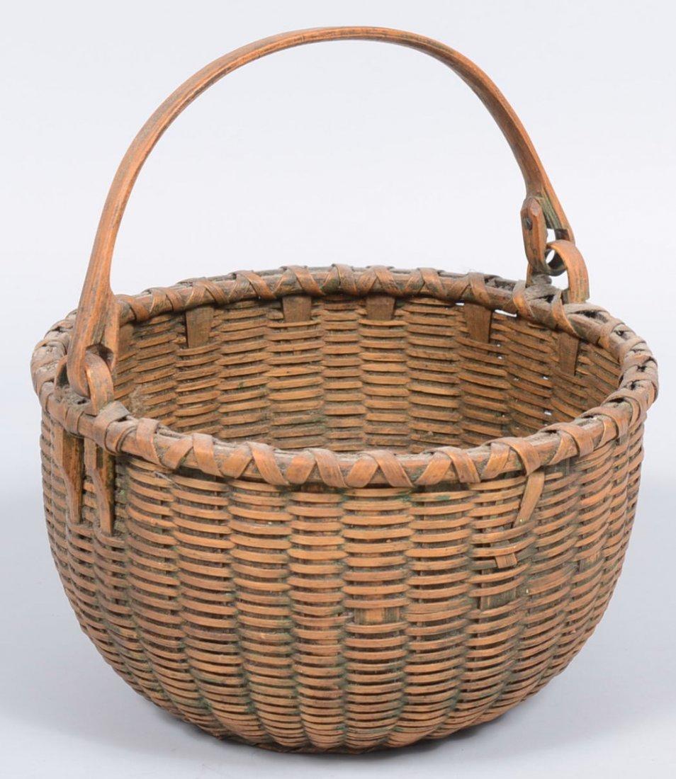 20. Round Woven Split White Oak Swing Handle Basket. A