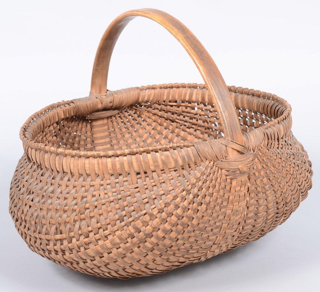 23. Woven Splint Oval Market Basket. Wide ovoid shape w