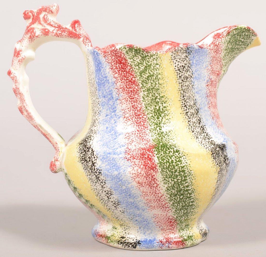 108. Five Color Rainbow Spatterware China Milk Pitcher.