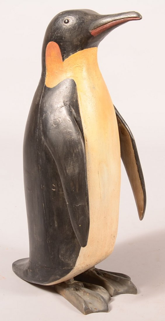 Miles Wooden Penquin Sculpture. Carved and realistic