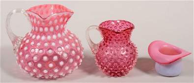 Three pieces of Blown Victorian Cranberry Art Glass.