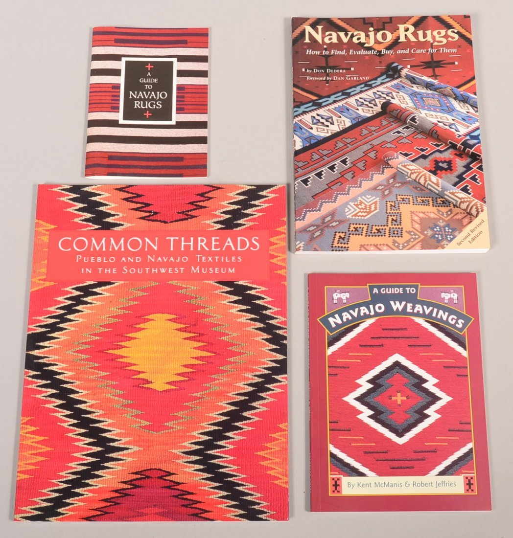 4 soft bound books relating to the study of Navajo