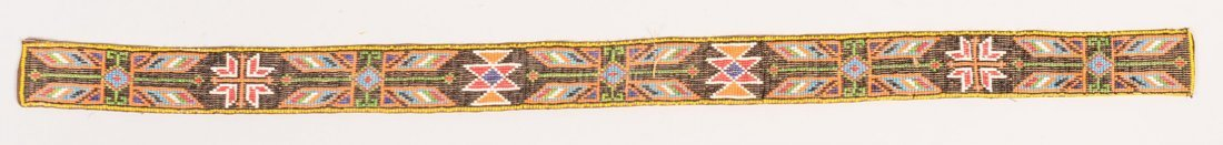 A vintage loom-beaded belt strip - backed with a
