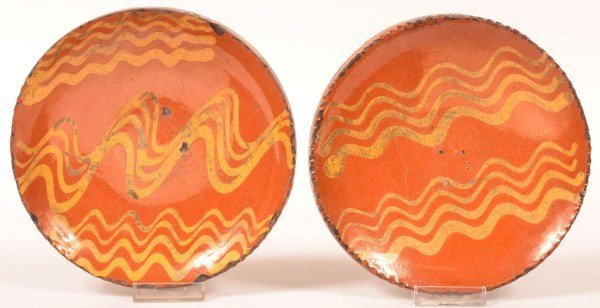 Two Shooner Redware Pottery Plates.