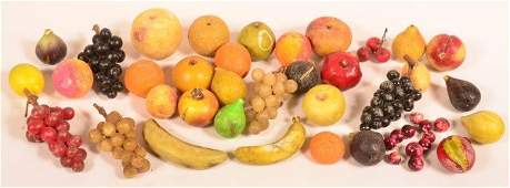 34 Pieces of Carved and Painted Stone Fruit.