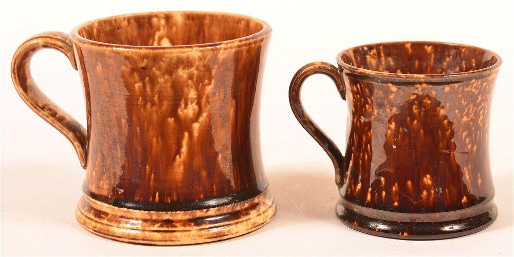 Two Rockingham Glazed Yellowware Mugs.