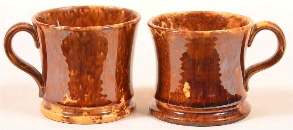 Two Rockingham Yellowware Child's Mugs.