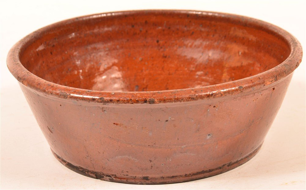 Redware Flared Edge Bowl with Molded Rim.