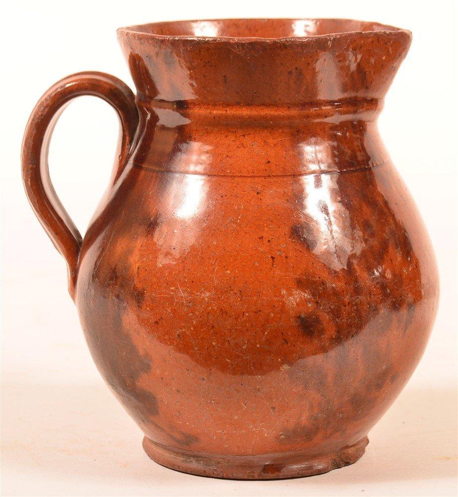 Redware Mottle Glazed Pottery Pitcher.