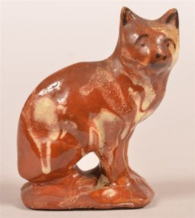 Mottle Glazed Redware Pottery Of A Seated Cat.