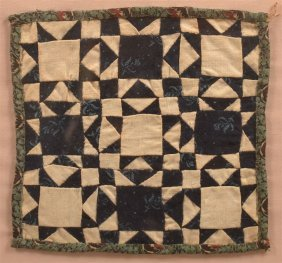 Framed 19th Century Miniature Patchwork Quilt.
