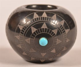 Pueblo Indian Carved Blackware Miniature Jar.