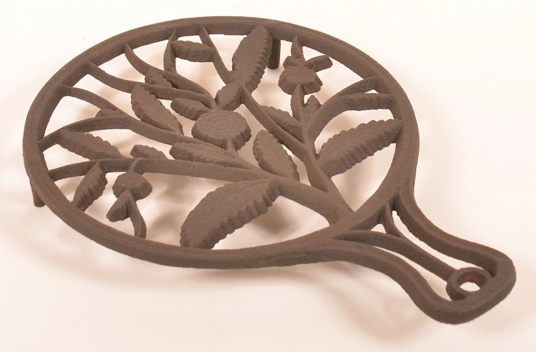 Cast Iron Floral and Foliate Pattern Trivet.