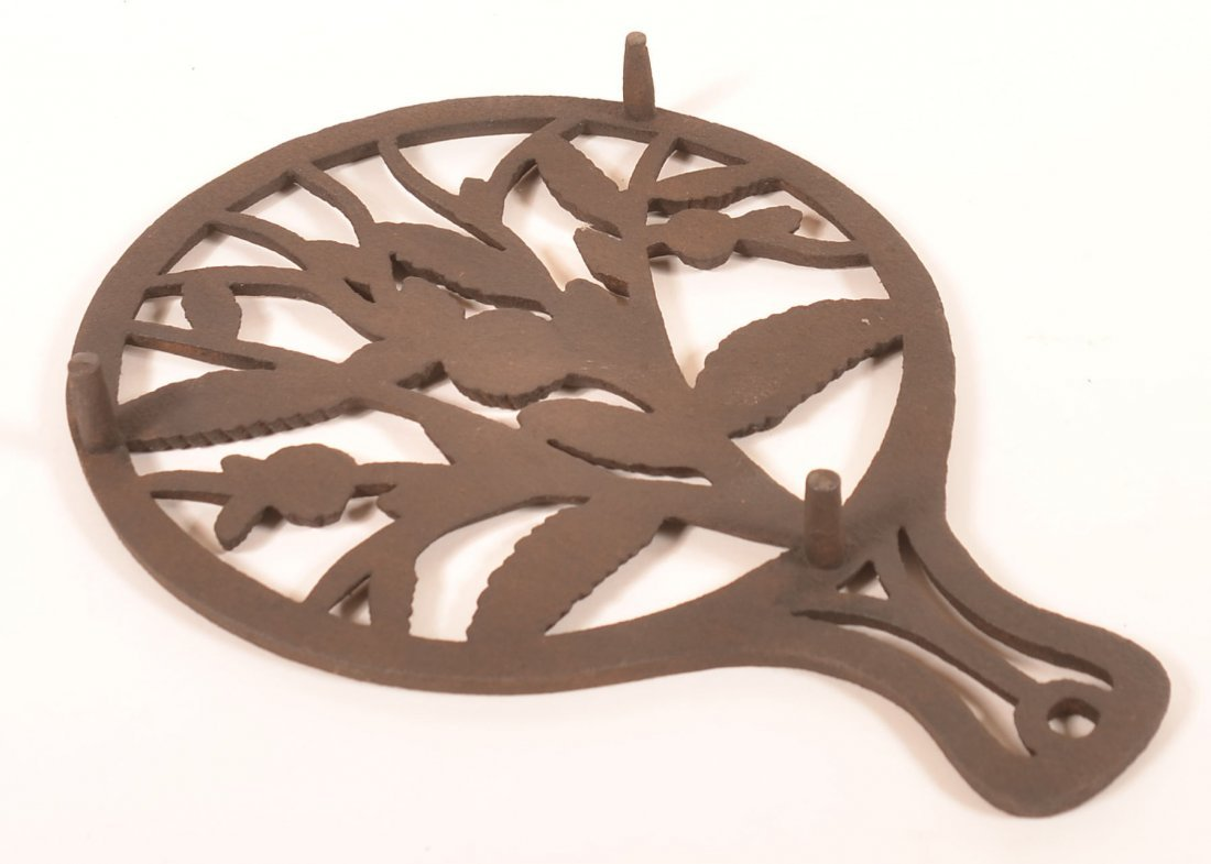 Cast Iron Floral and Foliate Pattern Trivet. - 2