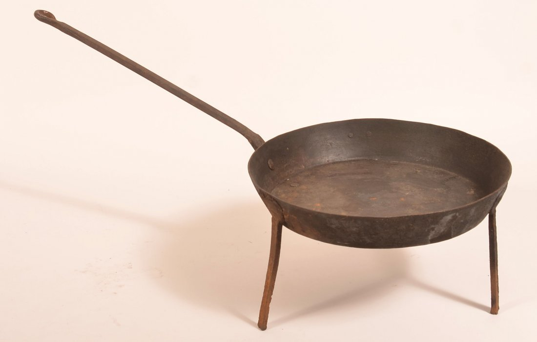 Wrought Iron Skillet with Tripod Base.