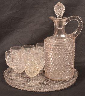Colorless Hobnail Glass Twelve Piece Liquor Set.
