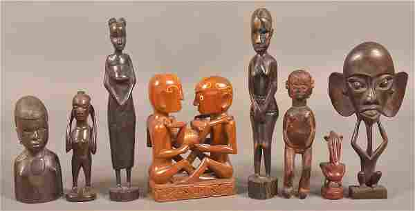 8 Vintage African Carved Wood Figures.