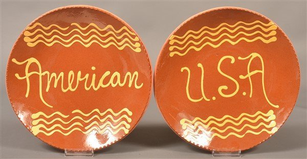 Two Breininger Pottery Slip Decorated Plates.