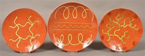 Three Breininger Pottery Slip Decorated Plates.