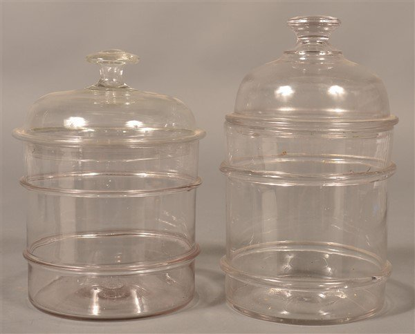 Two Antique Blown Colorless Glass Canisters.