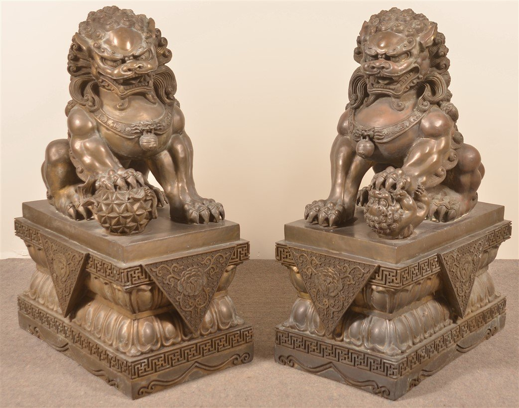 Pair of Vintage Hollow Cast Bronze Foo Dogs.