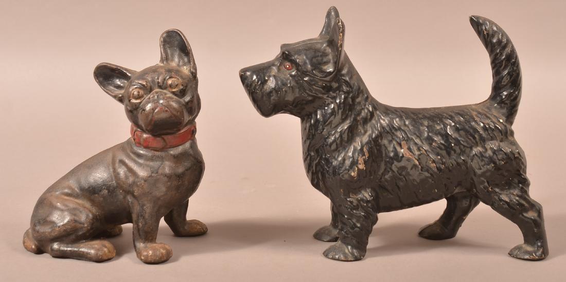 Two Hubley Cast Iron Dog Doorstops.