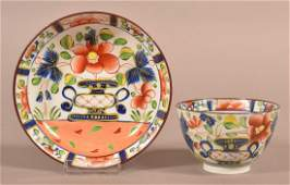 Gaudy Dutch China Urn Pattern Cup and Saucer.