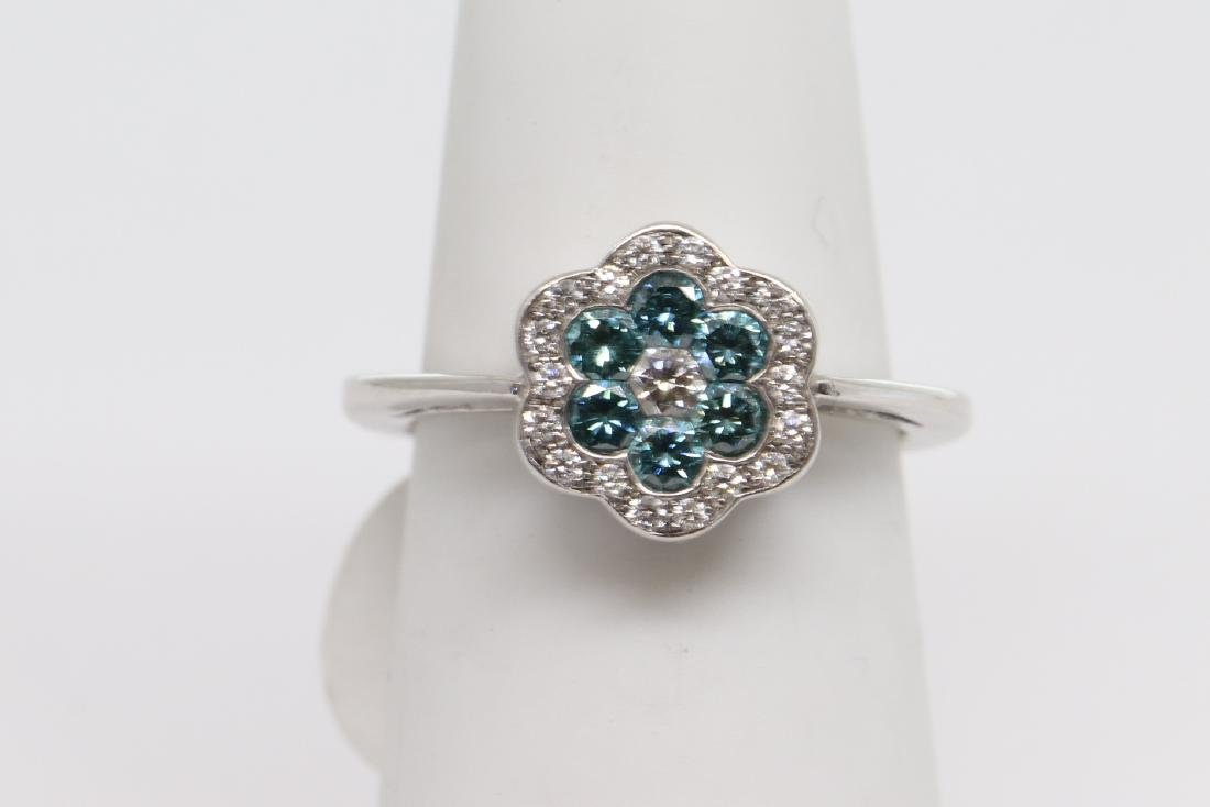 14k white gold with blue diamonds
