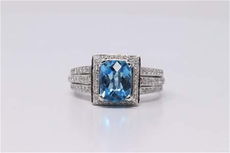 18Kt White Gold Blue Topaz Diamond Ring.