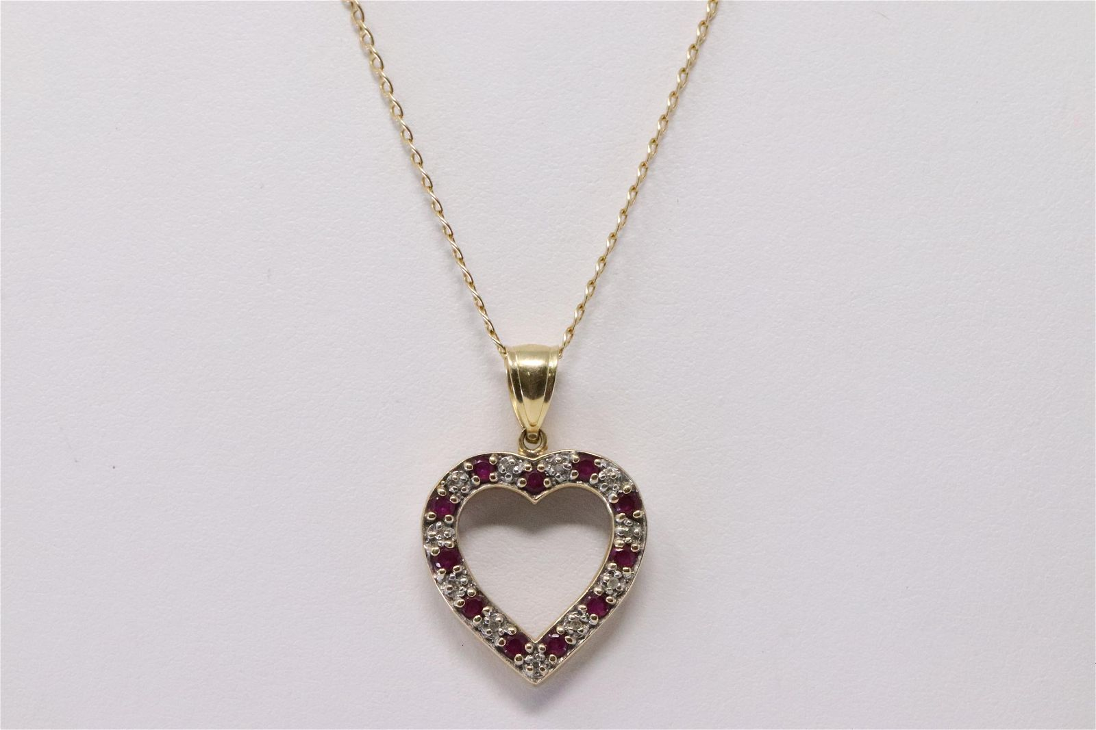 14Kt Yellow Gold Ruby Diamond Heart Pendant & Necklace.