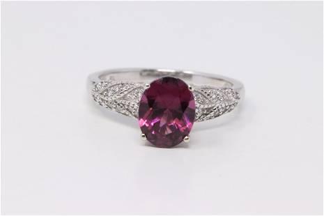 14KT Ladies White Gold Diamond / Tuormaline Ring.
