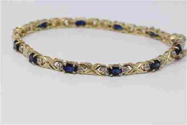 Lady's Yellow Gold Diamond | Sapphire Bracelet.