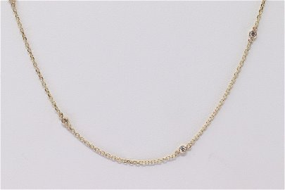 14Kt Yellow Gold Diamond Necklace.